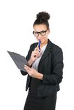 Young business woman holds a clipboard. Cut out image of a young beautiful business woman who holds a clipboard and a pen Royalty Free Stock Images