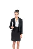 Young business woman holds a file. Cut out image of a young beautiful business woman who holds a closed file Royalty Free Stock Image