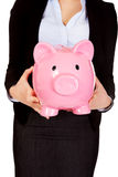 Young business woman holiding piggybank Royalty Free Stock Image