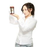 Young business woman with hourglass Stock Photo