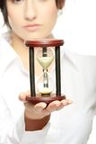 Young business woman with hourglass. Time concept Royalty Free Stock Photo