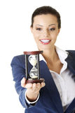 Young business woman with hourglass Royalty Free Stock Image
