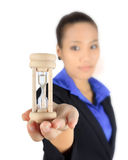 Young business woman with an hourglass Stock Images