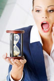 Young business woman with hourglass - time concept Royalty Free Stock Photography