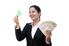 Young business woman with house model and Indian currency Stock Images