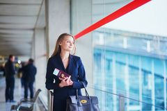 Young business woman in international airport Stock Photography