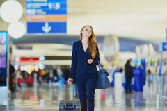 Young business woman in international airport Stock Photo
