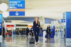 Young business woman in international airport Royalty Free Stock Image