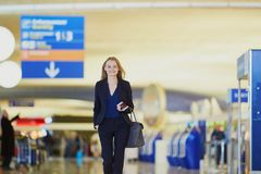Young business woman in international airport Stock Image