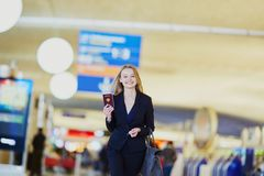 Young business woman in international airport Stock Images