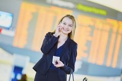 Young business woman in international airport Royalty Free Stock Photos