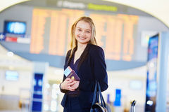 Young business woman in international airport Stock Photos