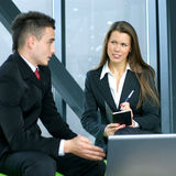 A young business woman interviews a man Stock Image