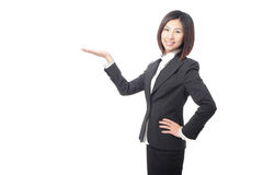 Young business woman introducing something Stock Photo