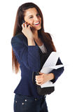 Beautiful businesswoman with papers and talking on smartphone Stock Photo