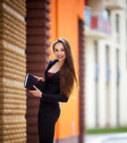 Young business woman , keeps a notebook and pen Royalty Free Stock Photo
