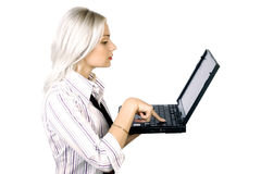 Young business woman with laptop Stock Photography