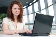 Young business woman with laptop Stock Photos