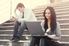Young business woman with laptop on the steps Royalty Free Stock Images