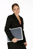 Young Business Woman with Laptop Under Arm Stock Photo