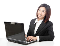 Young business woman on a laptop using computer Stock Photo