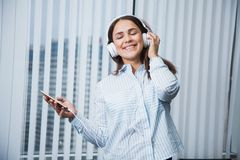 Young business woman listen to music on her leisure time at work office. Young business woman listen to music on her leisure time at work. Attractive female Stock Images
