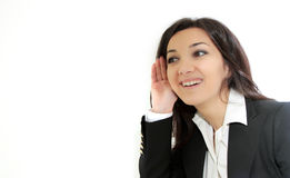 Young business woman listening gossip Royalty Free Stock Image