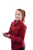 Young business woman. Business woman listing to music on her phone Royalty Free Stock Image