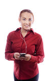 Young business woman. Business woman listing to music on her phone Stock Photo