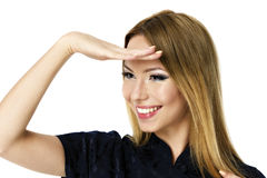 Young business woman  looking far away. Cover her eyes from the sun, over a white background Stock Images