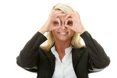 Young business woman looking through fingers Royalty Free Stock Images