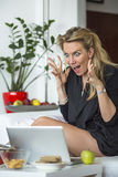 Young business woman looking at a laptop in a state of shock. Royalty Free Stock Photo