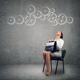 Young business woman looking at the mechanism Royalty Free Stock Photo