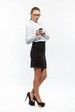 Young business woman looking message on cellphone Royalty Free Stock Image
