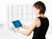 Young woman looking at modern tablet Royalty Free Stock Images