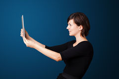 Young woman looking at modern tablet Royalty Free Stock Photos