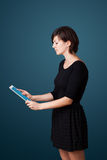 Young woman looking at modern tablet Stock Images