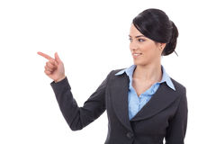 Young business woman looking and pointing Royalty Free Stock Image