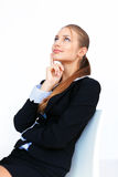 Young business woman looking up Stock Images