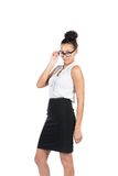 Young business woman looks over her glasses Stock Image