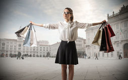 Young business woman with lots of shopping bags Royalty Free Stock Photo