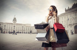 Young business woman with lots of shopping bags Royalty Free Stock Image