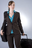 Young Business Woman with Luggage Royalty Free Stock Images