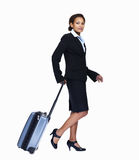 Young business woman with luggage on white Royalty Free Stock Photo