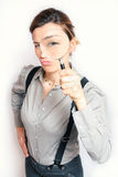 Young business woman. With magnifying Royalty Free Stock Photos