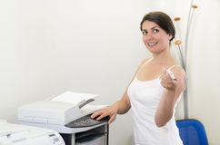 Young business woman making copies Stock Photography