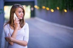 Young business woman making a phone call on her smart phone.  Stock Photography