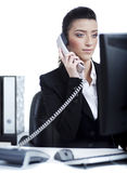 Young business woman making a phone call at office Royalty Free Stock Photos