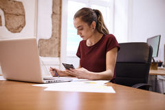Young business woman making some notes Royalty Free Stock Image