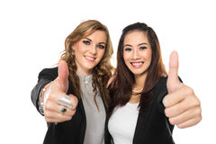 Young business woman making thumbs up gesture wearing blouse and Stock Images